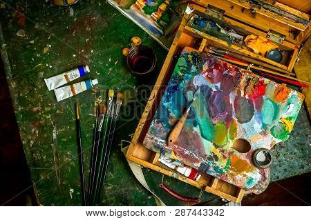 Workplace Of The Artist With Brushes And Oil Paints