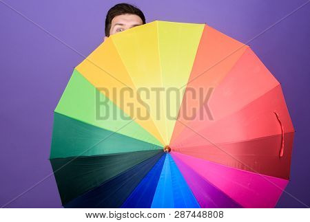 For Both Rainy And Sunny Day. Homosexual Man Holding Colorful Umbrella. Gay With Open Folding Umbrel