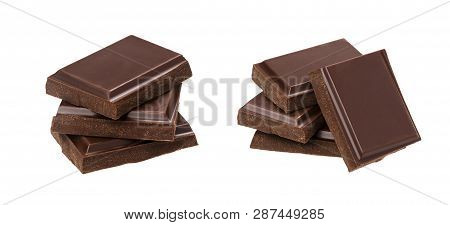 Dark Chocolate Bars Isolated On White Background. Stack Of Chocolate Pieces, Closeup