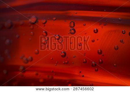 Bubbles In A Red Oil Liquid