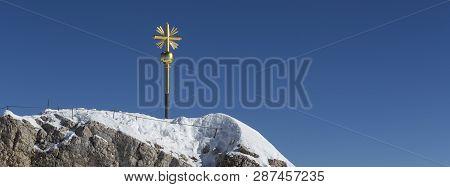 Panorama Golden Summit Cross At Zugspitze, Bavaria, Germany, Wintertime
