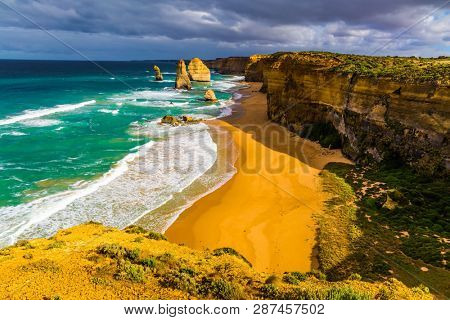 Magic light on the Pacific coast near Melbourne. The Great Ocean Road. Rocks Twelve Apostles in ocean waves surf. Travel to Australia. The concept of active and phototourism