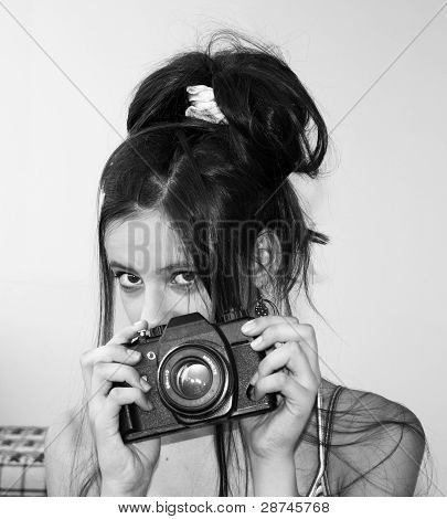 Young Girl Holding A Camera