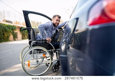 Handicapped Man Attempting To Get In The Car