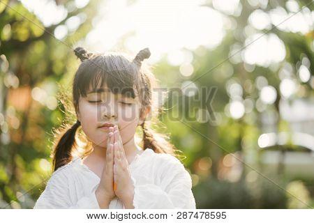 Little Girl Praying. Kid Prays. Gesture Of Faith.hands Folded In Prayer Concept For Faith,spirituali