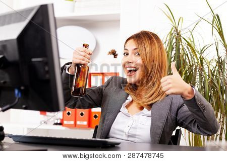 Happy Business Woman In An Office