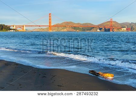 Surf In Front Of Golden Gate Bridge Worldwide Known Symbol Of California