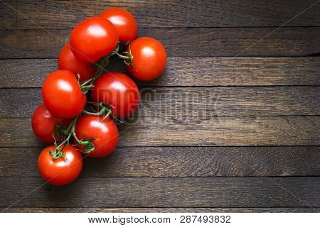 Tomatoes On Wooden Table With Copy Space