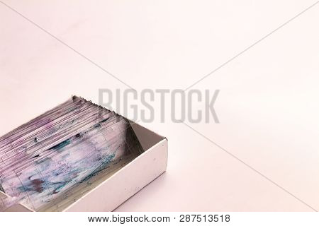 Small glasses with pieces of histological biopsies in a box on white background. Free space to write. poster
