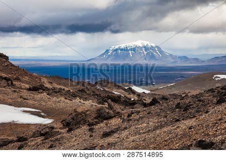 Stormy clouds over the Herdubreid tuya (flat-topped steep-sided volcano) mountain in Ódáðahraun lava field, Highlands of Iceland, Scandinavia, as viewed from Askja volcano