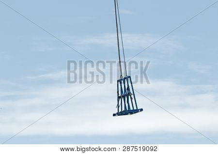 Gosford, New South Wales, Australia - January 31, 2019: Tower Crane Unloading A Cradle From New Home
