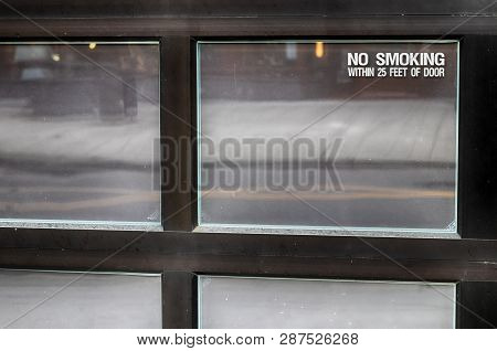 Abstract Window With No Smoking Sign In Daylight