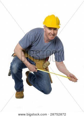 Kneeling Construction Worker Measures