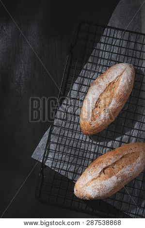 Baguette, European Style Bread On Black Wood Table In Morning Time With Hard Light Effect. Organic A