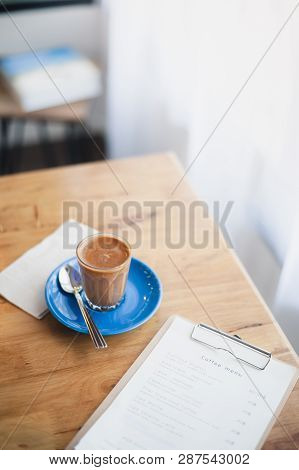 Abstract Emotional Scene Of Hot Piccolo Latte In Small Coffee Glass On Table At Cafe In Morning Time