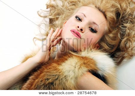 Sensuality Young Attractive Girl With Fur Coat