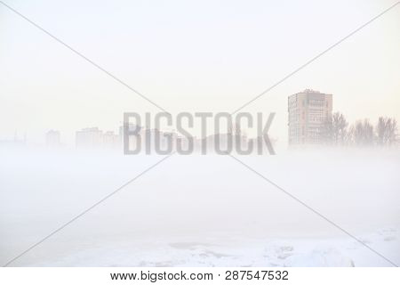 Cityscape With Residential Buildings On A Foggy Winter Day On The Outskirts Of St. Petersburg, Russi
