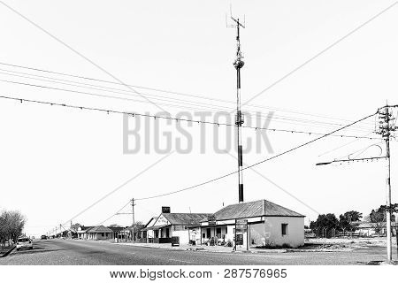 Ventersburg. South Africa, July 30, 2018: A Street Scene, With Businesses And A Telecommunications T