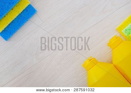 Cleaning Service Concept. Cleaning Set With Tools And Products On Light Wooden Background. Flat Lay