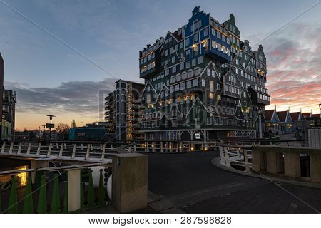 Sunset On Building Made Of All Type Of Dutch Architectural Style Topped Up On Each Others Making Thi