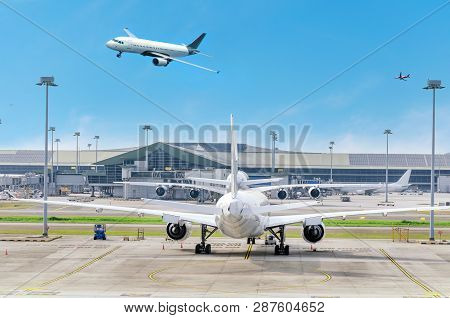 Airport View With Aircraft In The Parking Lot, Airplane Landing, Plane Flying In The Sky. Air Logist