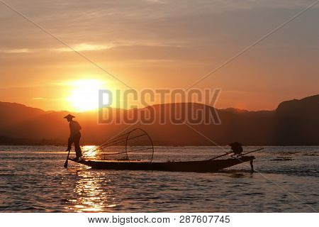 Inle Lake, Myanmar - January 11, 2017: Fisherman Silhouette At The Sunset On The Inle Lake, Myanmar