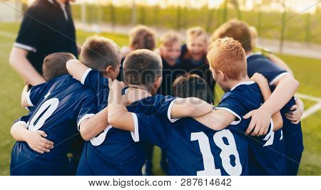 Boys Sport Team Huddle. Kids Of Soccer Team Gathered Before The Tournament Final Match. Coach And Yo