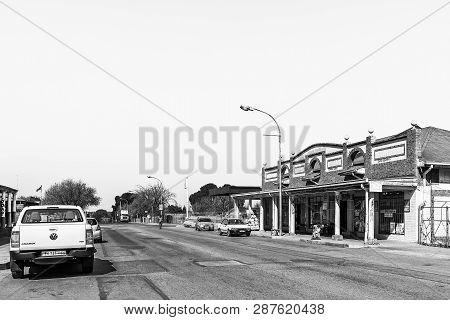 Koppies, South Africa, July 30, 2018: A Street Scene, With Businesses And Vehicles, In Koppies, A To