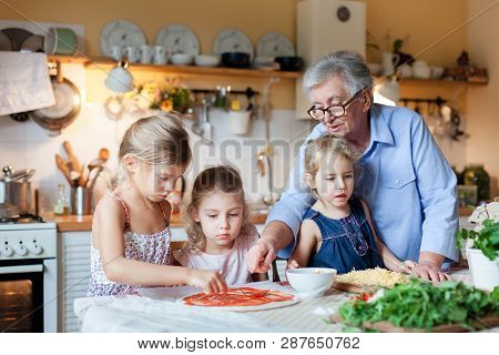 Pizza Cooking Class For Kids, Children Chef. Cute Girls Are Preparing Italian Food. Family Dinner In