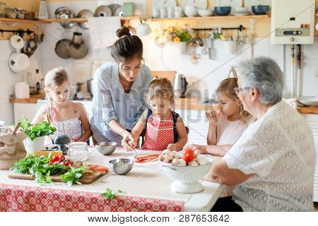 Family Are Cooking Italian Pizza Together In Cozy Home Kitchen. Cute Kids, Mother And Grandmother Ar
