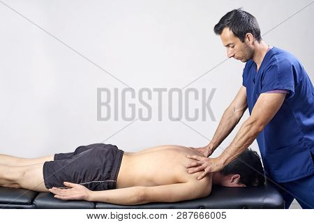 Physiotherapist Doing A Mobilization Neck Of Female Patient. Manual Therapy.  Neurological Physical