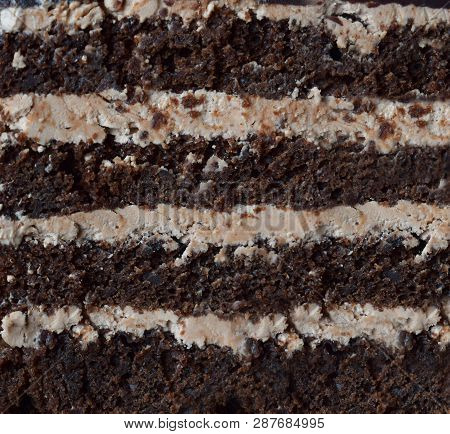 Close-up Piece Of Chocolate Cake: Chocolate-nut Biscuit, Caramel Cream. Homemade Baking.