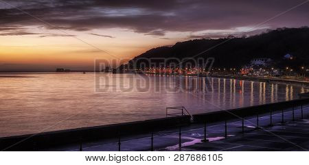 Editorial Swansea, Uk - February 19, 2019: Daybreak At The Tourist Area Of Mumbles Town In Swansea,