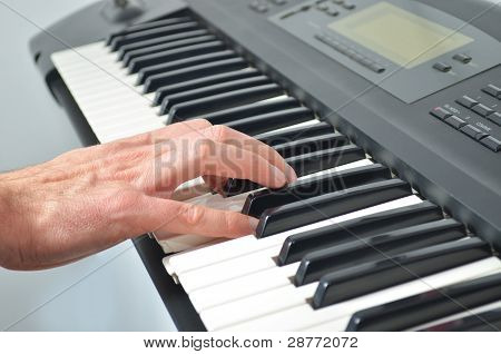 Hand Playing Electronic Keyboard