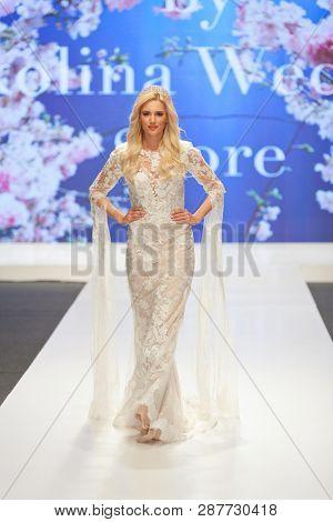 ZAGREB, CROATIA - FEBRUARY 02, 2019: Fashion model wearing a beautiful wedding dress, on the catwalk of the Wedding fair