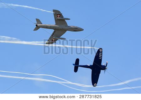 Payerne, Switzerland - September 8, 2014: Hawker Sea Fury Fb.11 F-azxj Flying In Formation With Hawk
