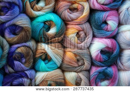 Background Of Colored Wool Skein. Yarn Skein, Colorful Thread In Skeins, Red Yellow Blue Pink Purple
