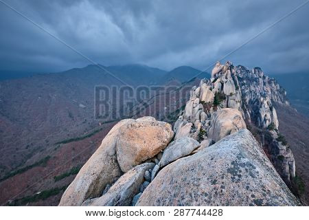 View of stones and rock formations from Ulsanbawi rock peak in stormy weather with clouds. Seoraksan National Park, South Corea poster