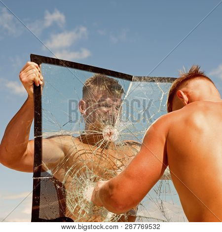 Full Of Energy. Twins Men Punch A Glass. Twins Competitors Show Muscular Strength And Power. Strong