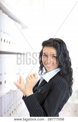 Closeup portrait of a happy young business womanchoose the document in her office