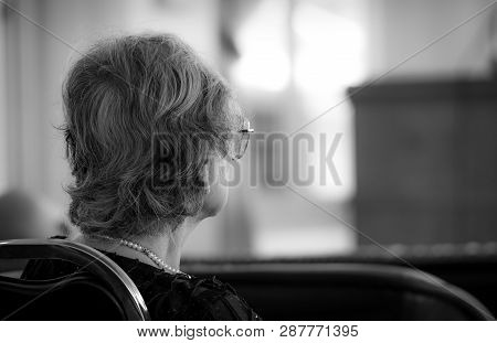 Back View Of Old Woman Sit On Chair. Elderly People Depressed And Anxiety. Aging Society Depression