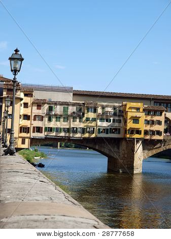 poster of The Ponte Vecchio /Old Bridge/ is a Medieval bridge over the Arno River in Florence Italy