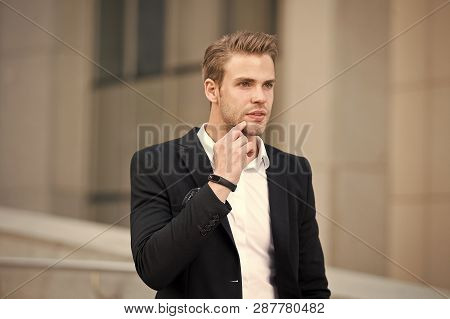 Man Formal Suit Businessman Well Groomed Urban Background. Professional Attire Wear In Professional