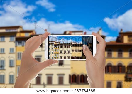 A Man Is Making A Photo Of Facades Of Different Old Houses On Piazza De Pitti In Florence, Italy On