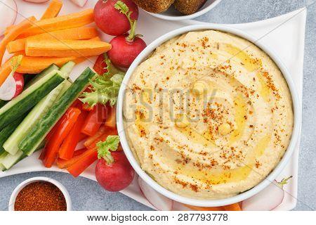 Hummus Dip Served With Fresh Vegetable Sticks And Falafel. Healthy Vegan Food.