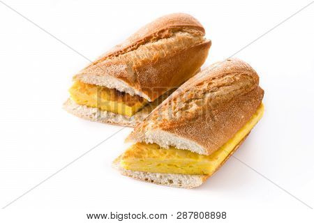 Bocadillo de tortilla espaсola. Spanish potato omelette sandwich isolated on white background poster