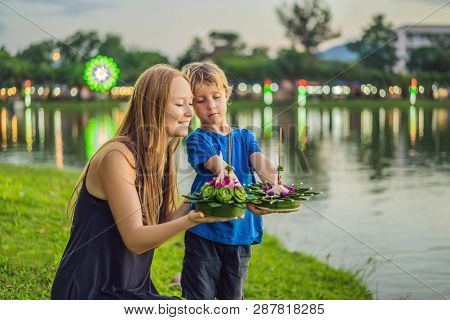 Mom And Son Tourists Celebrates Loy Krathong, Runs On The Water. Loy Krathong Festival, People Buy F