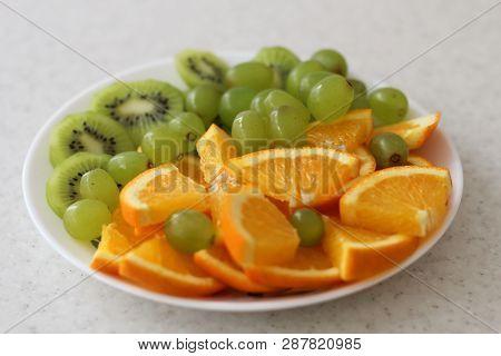 White Fruit Plate With Grapes, Orange, Kiwi