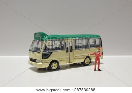 The Toys Of Minibus Figure With White Background