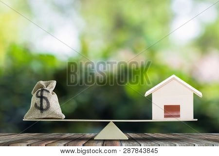Home Loan, Home To Money, Change Real Estate Into Cash Concept. Us Dollar In Sack Bag, Wooden House